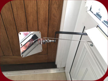 Stainless-steel Locksmiths Mirror passed through a letterbox and shown on the inside of a door