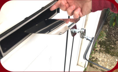Locksmiths Letterbox Tool Stainless-Steel Mirror being passed through a letterbox in a white door