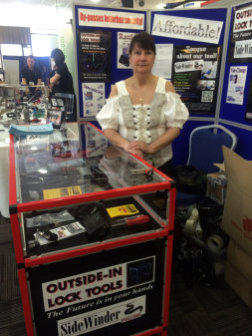 Wendy stands behind the Outside-In Lock Tools counter at a Trade Show
