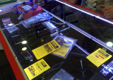 A display of Locksmiths tools in the counter at a trade show