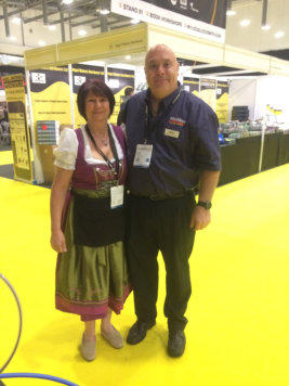 Wendy stands next to a Locksmith at the Outside-In Lock Tools trade stand