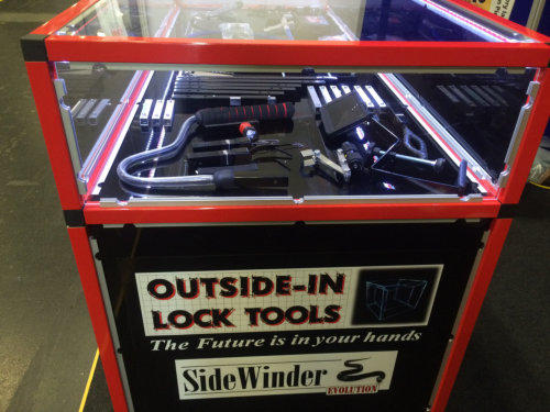 Side view showing Locksmiths tools behind glass in a counter at a Locksmiths Trade Show