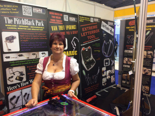 Wendy stands behind the trade counter at a Locksmiths trade show