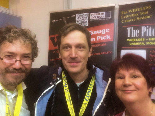 Head and shoulders photo of three smiling Locksmiths at a Locksmiths Trade Show