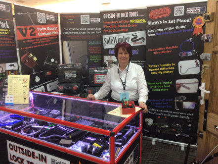 Wendy standing behind Outside-In Lock Tools counter at a Locksmith Trade Show