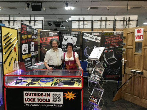 Simon and Wendy at a Locksmiths Show standing behind their trade show