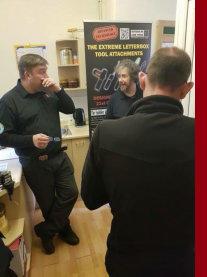 Three men laughing and joking at a Locksmiths training session