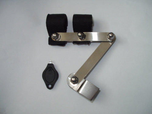 Silver metal articulated bracket for camera with black straps and a small flat black torch