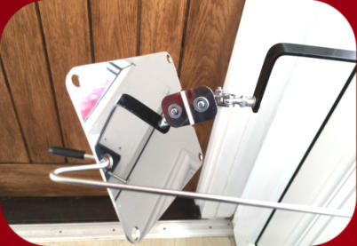 Mirror on a black metal clamp pushed through letterbox