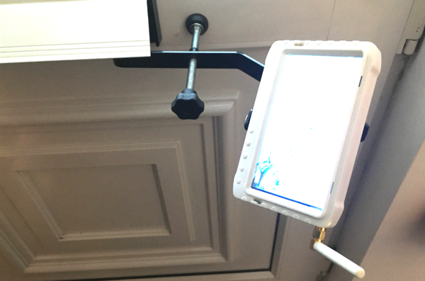 Inside of a door with Monitor bracket through the letterbox and white monitor attached