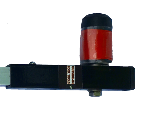Black metal tool with red cylindrical section at right angles